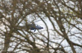 Boeing AH-64D Apache behind the trees