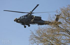 Boeing AH-64D Apache obove the trees