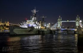 HMS Belfast with Tower Bridge at night
