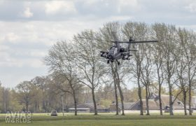 Boeing AH-64D Apache at treetop level